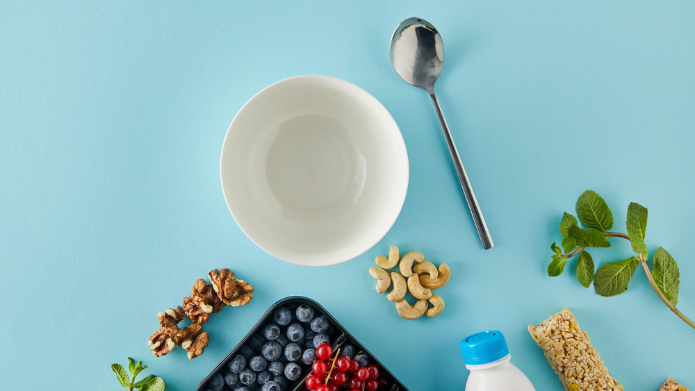 Empty cereal bowl surrounded by fruit