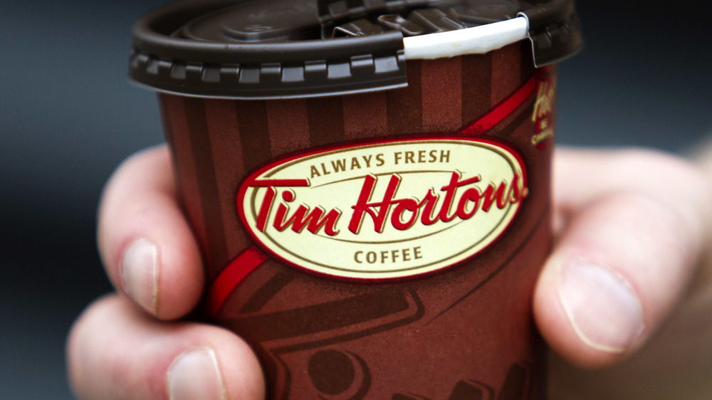 Tim Hortons coffee cup hand