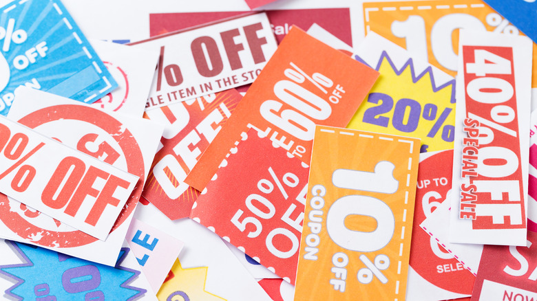 Colorful coupons scattered on surface