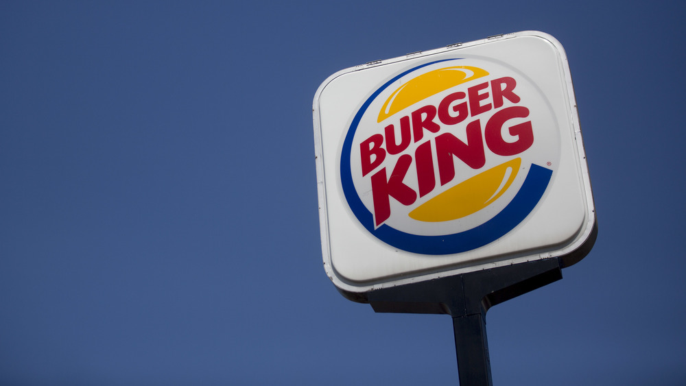 Burger King sing with blue sky background
