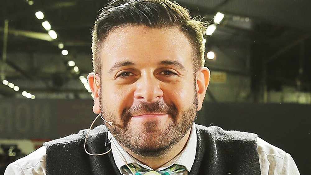 Adam Richman smiling of stage