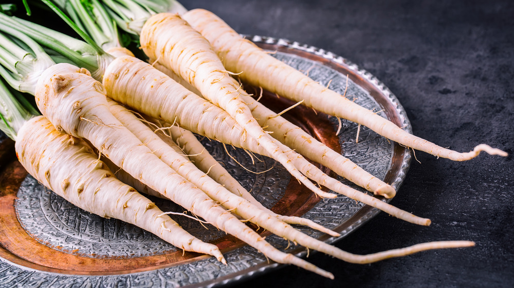 Whole parsnips on a plate