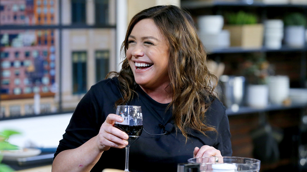 Rachael Ray with wine, smiling
