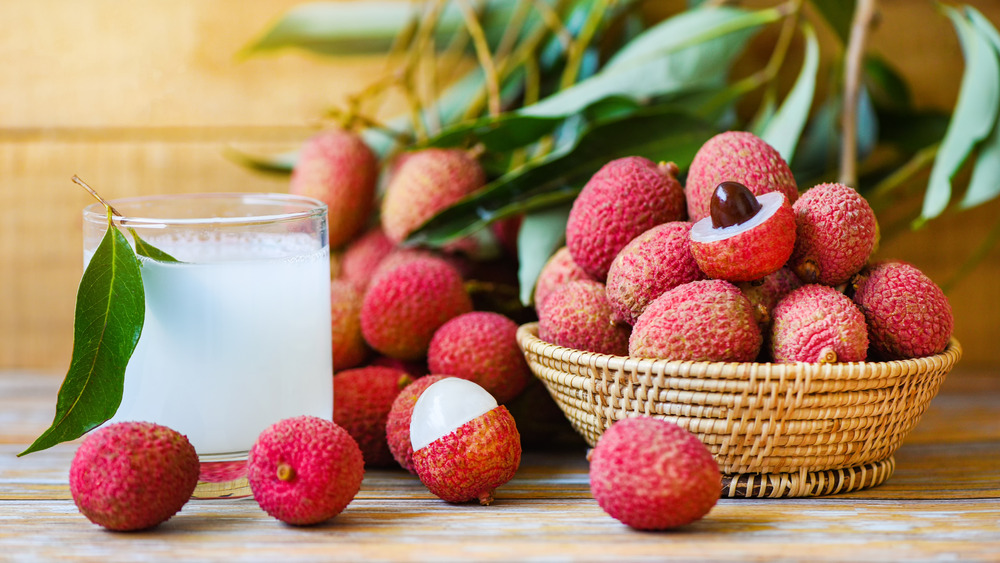 Basket of lychees, with juice