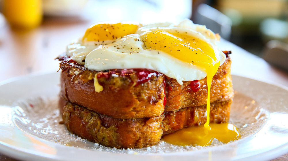 French toast stack with runny egg