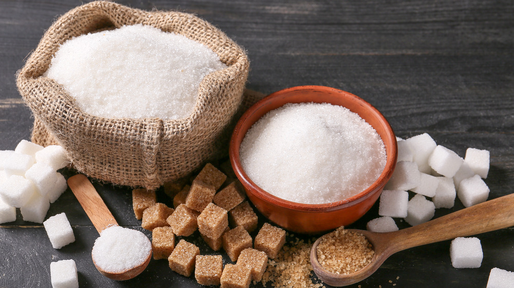 Sugars in bowls and spoons