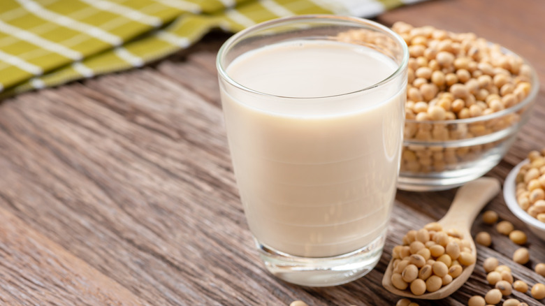 Glass of soy milk with soybeans
