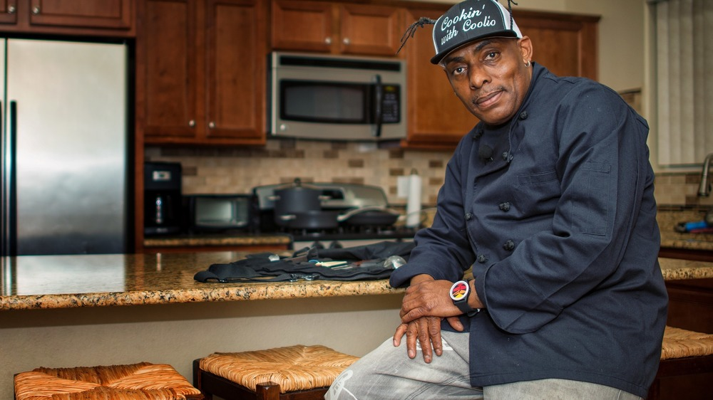 Coolio posing in a kitchen