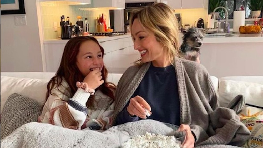 Giada De Laurentiis and daughter snuggle on couch