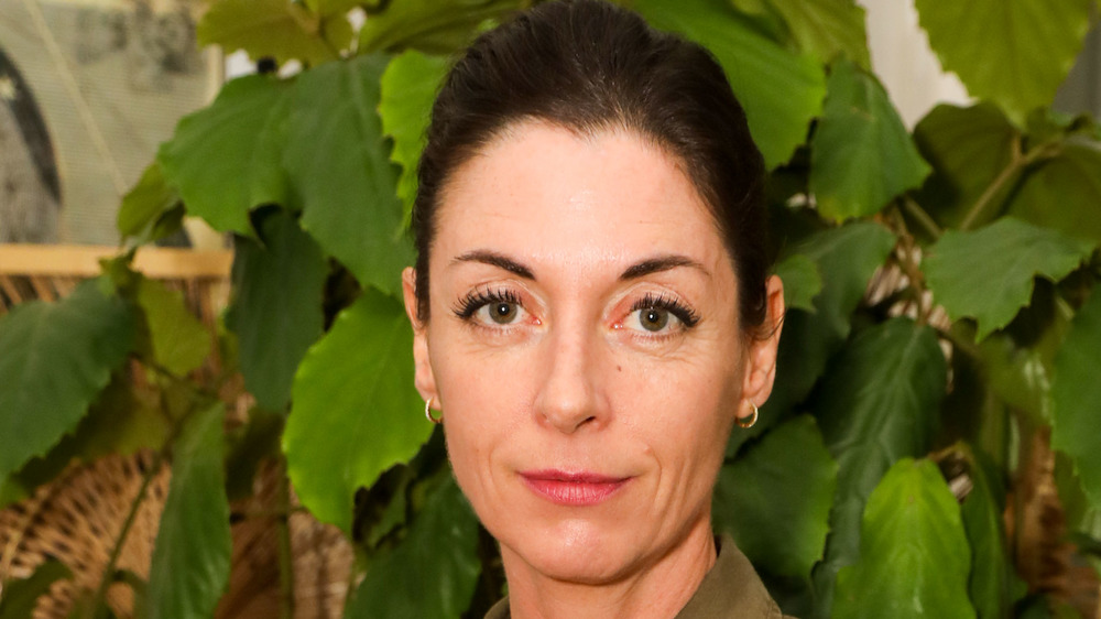 Mary McCartney in front of plants