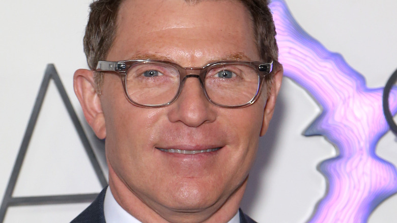 Bobby Flay in round glasses