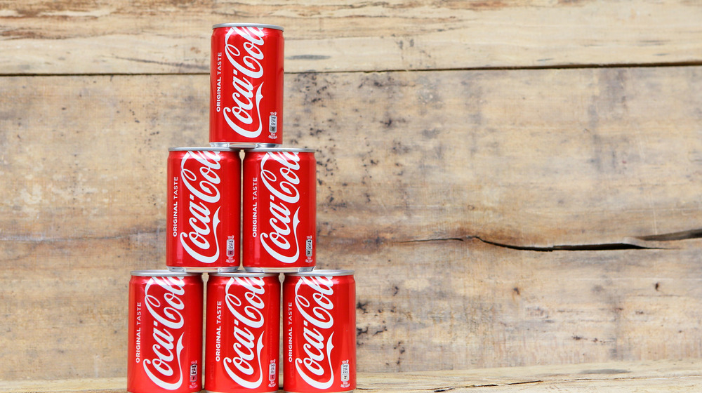 Coca-Cola cans in a stack