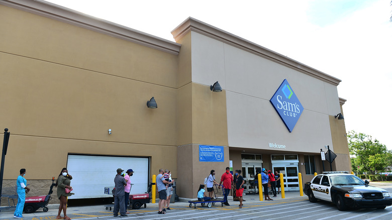 Sam's Club with line of shoppers outside