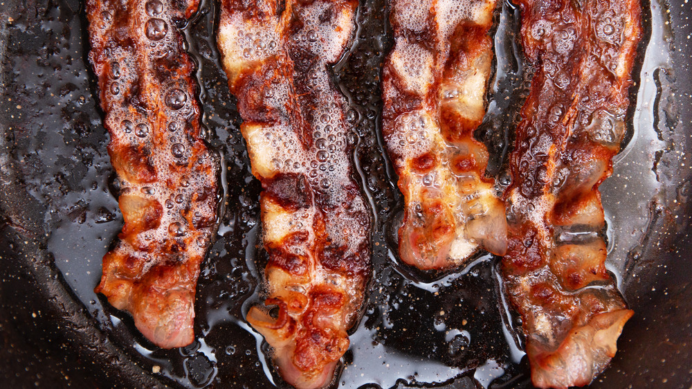 Bacon sizzling in pan