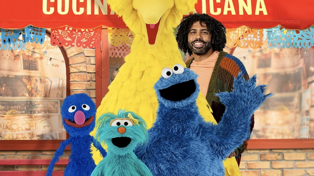Grover, Rosita, Cookie Monster, Daveed Diggs, and part of Big Bird