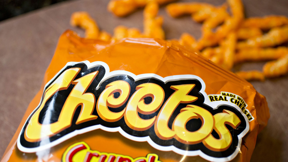 Top of an open bag of Cheetos, Cheetos in the background