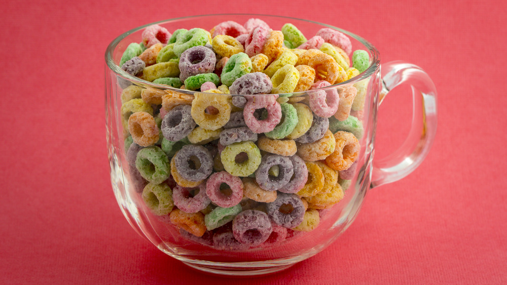 Froot loops in a mug on a red background