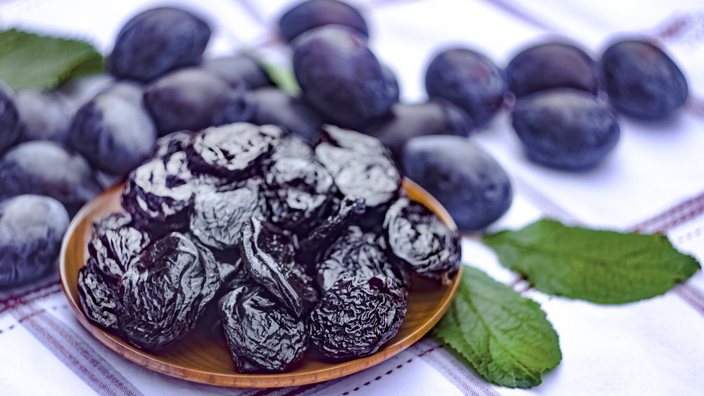 prunes and plums on a checked tablecloth