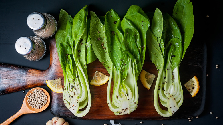 Hearts of romaine on wooden board with seasonings